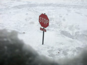 stop sign in snow storm
